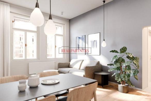 Byt 3+kk o ploše 83,7 m² v historickém domě v památkové zóně Žižkov.